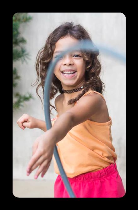 girl playing wih a hula hoop